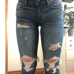 AMERICAN EAGLE RIPPED SKINNY JEANS MID WASH